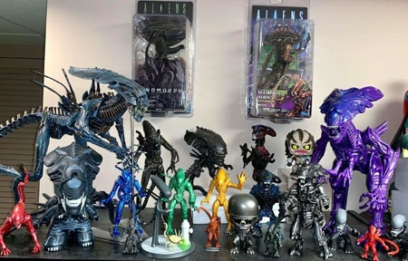aliens_on_top_of_shelves